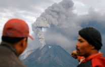 Residents observe Mt Sinabug from their village in Northern Sumatra. The volcano hasn't erupted in 400 years. (Photo: AFP)
