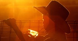 An Aboriginal boy taking a drink at the Mt Isa Rodeo; the biggest in Australia, it can attract 10,000 visitors (AAP/Dave Hunt).