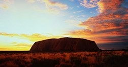 Controversy surrounds tourists climbing Uluru, NT (Photo: Getty Images)
