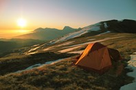 You need to know how to spot a good setting for your tent. (Credit: Getty images)