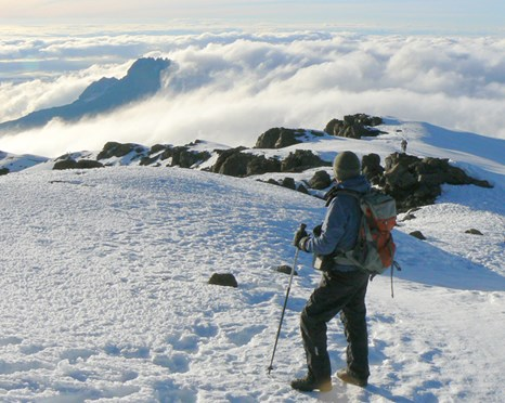 Trekking with poles can reduce the amount of weight your legs are carrying. (Credit: Ian Arnold)