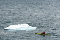 Kayaking close to icebergs can be dangerous as they regularly roll over. (Credit: Ken Eastwood)