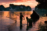 Local women fish for shrimp at sunrise. (Photo: Frits Meyst)