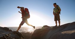 Ligthweight hiking gear can help you move faster and take a load off sore muscles. (Credit: Getty Images)
