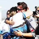 Ryan, 19, embraces his mother after he becomes the youngest person to fly solo around the world. (Credit: Amy Russell)