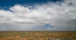 Rain showers on the Nullarbor horizon and a very green-looking landscape.  (Photo: Carolyn Barry).