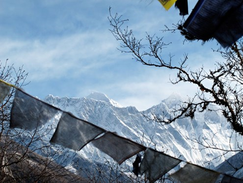 View from Tengboche of Everest and Lhotse; prayer flags in the foreground (Photo: Ian Connellan)