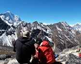 Alistair Walpole and host Lincoln Hall consult the map at 5000 m on Ama Dablam's south-west flank (Photo: Ian Connellan)