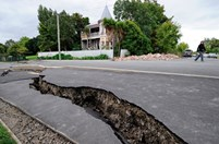 A crack in the road is a reminder of the 22 February 2011 earthquake in Christchurch, New Zealand. (Credit: Getty)