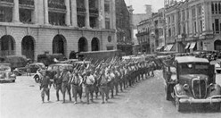 Japanese troops marching through Singapore's Fullerton Square. (Credit: Wikimedia)
