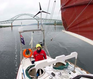 Sailing under the Seal Island bridge, Bras d'Or lake, Novascotia Canada, 2010. (Credit: Chris Bray)