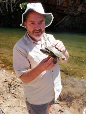 Volunteer Tony Spurling holds a red-faced turtle at Moonshine Gorge, El Questro Wildreness Park, W.A