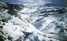 Winding down from the Australian Alps is the Snowy River, stopped by the Guthega Dam. (Photo: Ross Dunstan)
