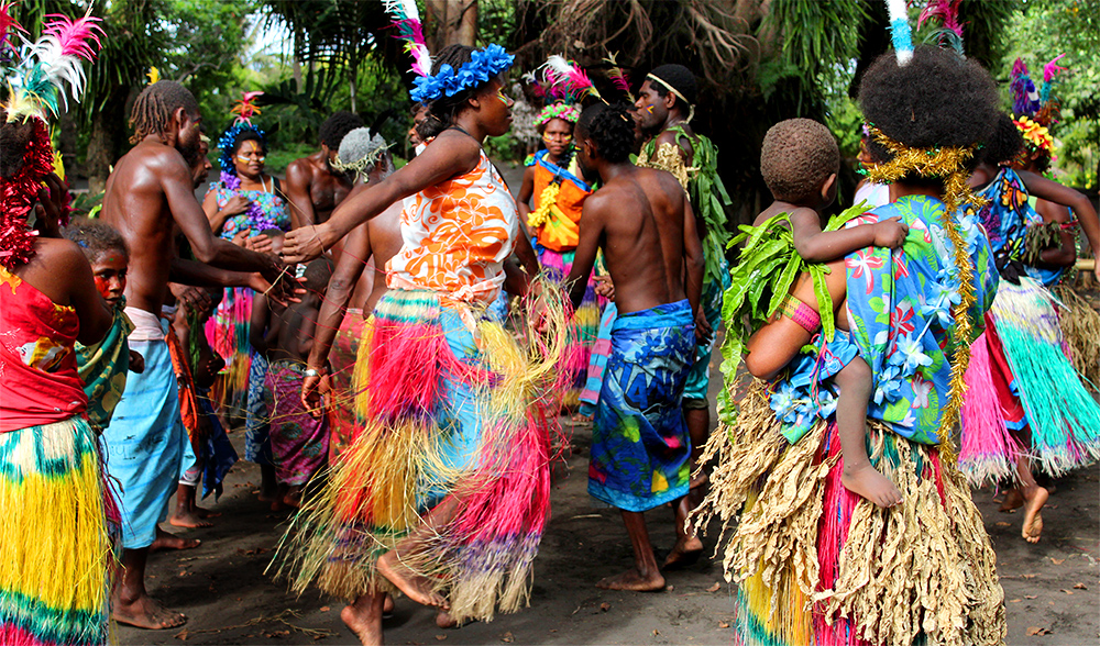 Friends and family of enima village gather in a display of traditional