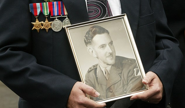A marcher holds a picture of a war veteran relative in the Anzac Day parade April 25, 2006 in Sydney, Australia.