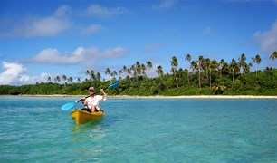 Paddling on the inside of the reef on Rarotonga - the point where the seven vaka once left to travel to New Zealand.