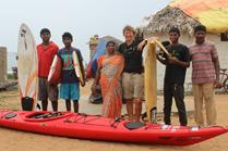 Sandy Robson(3rd, from right), stands with her kayak, among some locals at Rushikonda Beach in India.