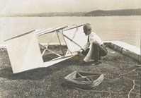 Lawrence Hargrave works on his invention of wings that created lift.