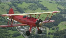 David Reyne flies in a vintage plane.