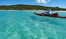 Photographer Andrew Gregory kayaking through the clear waters of Hill Inlet, Whitsunday Island.