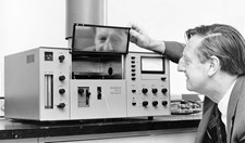 Sir Alan Walsh with a commercial model of the atomic absorption spectrophotometer, which is regarded as one of the most important aids to chemical analysis developed this century.