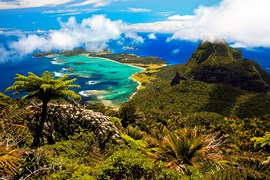 Lord Howe Island, as viewed from 875m Mt Gower, features lush rainforest, rugged terrain, subtropical beaches, and an idyllic coral-filled lagoon. The Admiralty Islands can be seen to the north.