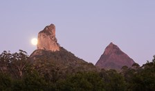 The moonrise over Mt Coonowrin in the Glass House Mountains.
