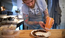 Stanley Street Merchants Matt Stone chef serving a plate of insects