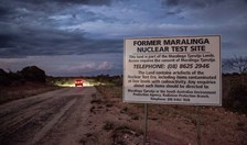 A car drives past the entrance of the former Maralinga nuclear test site.