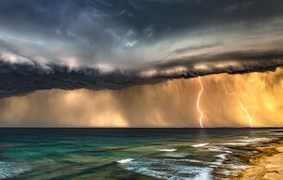 The distance crack of lightning echoes across Thirteenth Beach in Barwon Heads, Victoria
