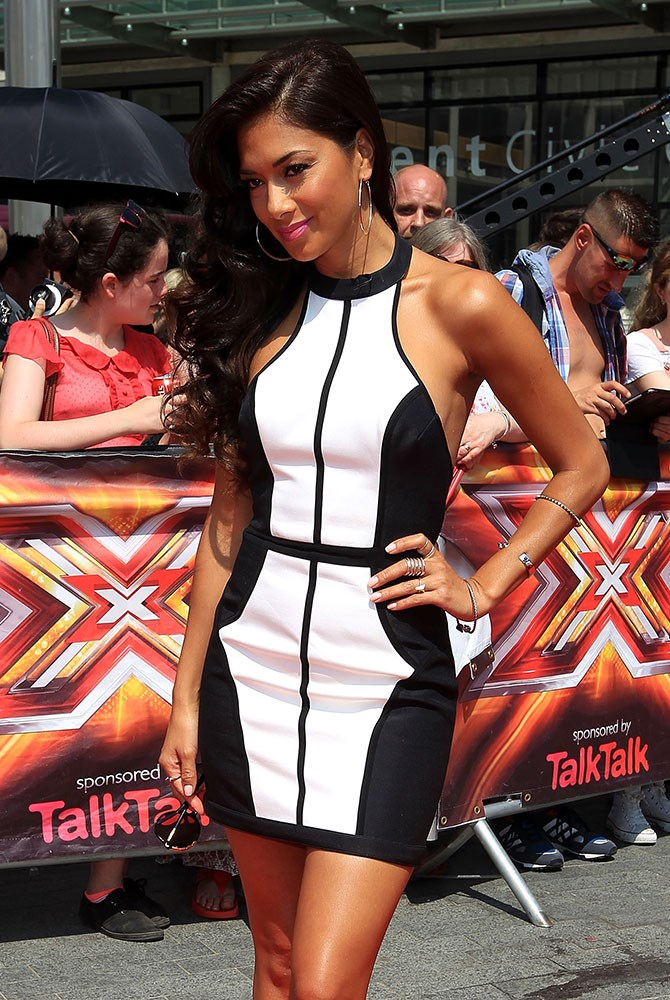 Outside *The X Factor UK* auditions, ex-Pussycat Doll Nicole Scherzinger donned a black and white body-con dress from Finders Keepers. In one word, she looks baben. Trust.