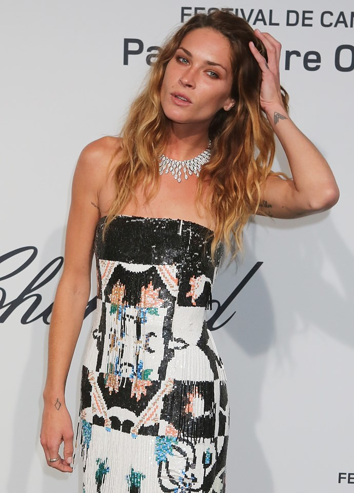 You can't really tell when she's got her arms down, but Erin Wasson is covered in secret tattoos. Many adorn the underside of her arms, and have symbolic meanings and native American inspiration.