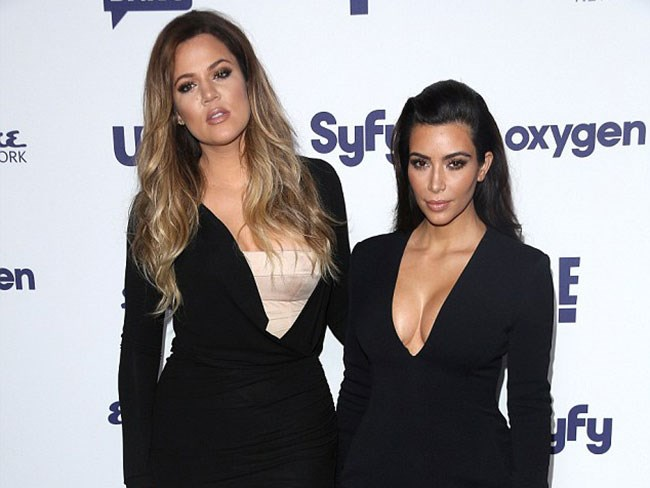 At a recent press event for the channel that makes them rich and famous, E!, Kim's cleavage was almost as fierce as her camera face. *Almost*.
