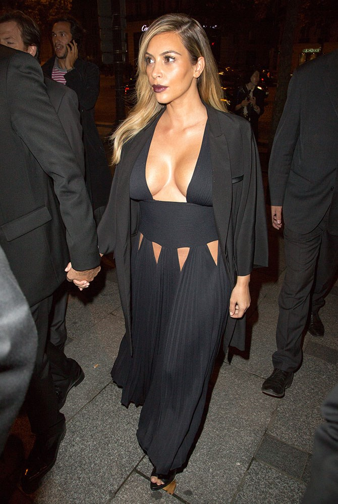 The one that started it all: Kim shocked the world by leaving almost nothing to the imagination in this number. Then again, we can't deny her boobs look *incred*.