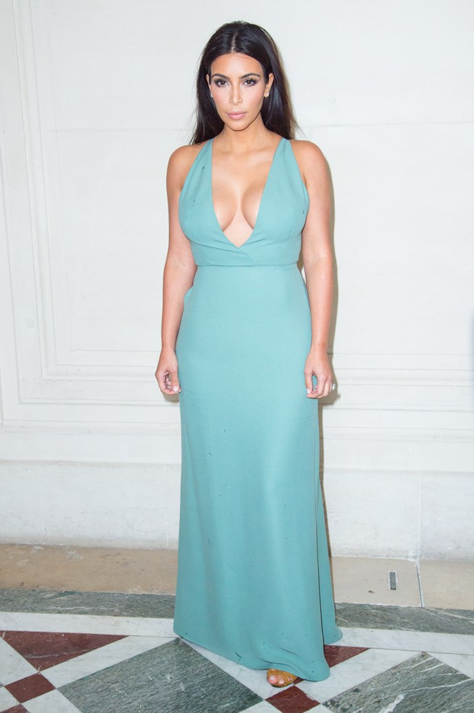 Kim used her ample chest to accessorise her plain old dress at Couture Fashion Week.