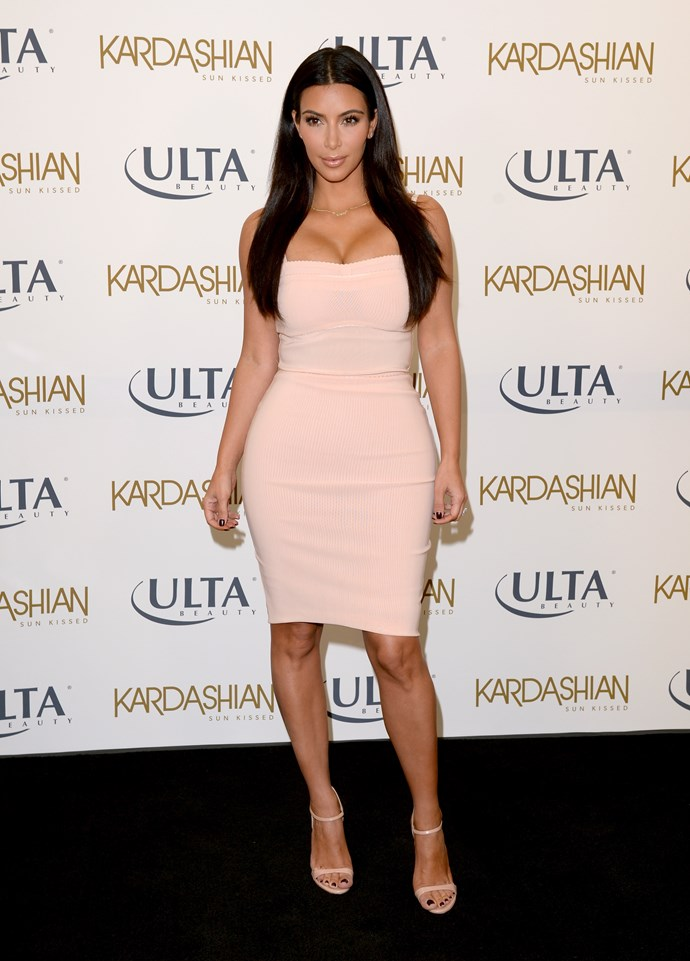 Tight – tick! Nude – tick! Major boobs – tick! It's Kim's failsafe fashion trifecta, ladies and gents.
