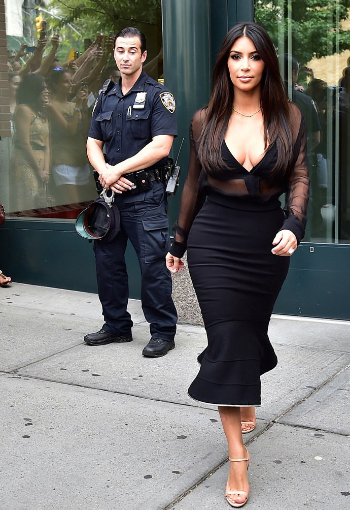 A sheer, undone top and a very revealing bra is just standard attire for a daytime stroll in Kim Kardashian's world. That cop can't believe his luck…