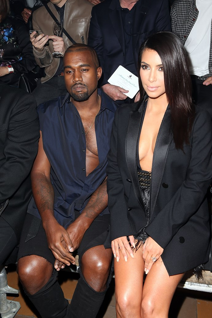 Kanye challenged his wife to a cleavage-off on the front row of the Lanvin show at Paris Fashion Week. Because that's what happens when two people this attention hungry get wed.