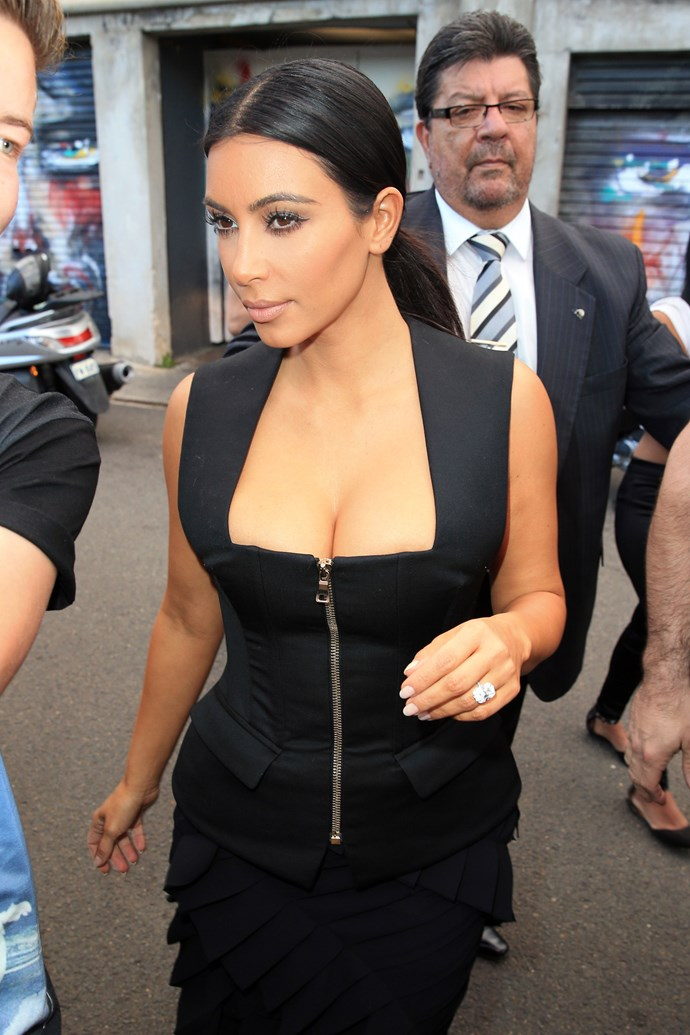 """As KKW touched down in Sydney she showed off some serious cleavage to mark her arrival. (In case you haven't seen enough of her [naked body](http://www.cosmopolitan.com.au/celebrity/celebrity-gossip/2014/11/kim-kardashian-goes-full-frontal-for-paper-magazine/