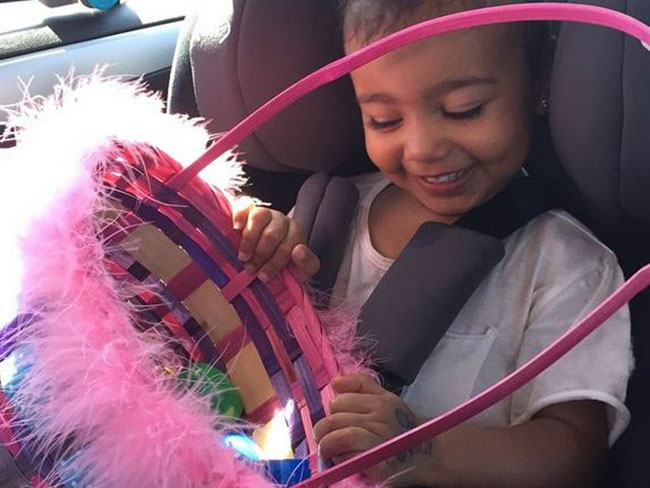 North West is the cutest Easter egg hunter ever