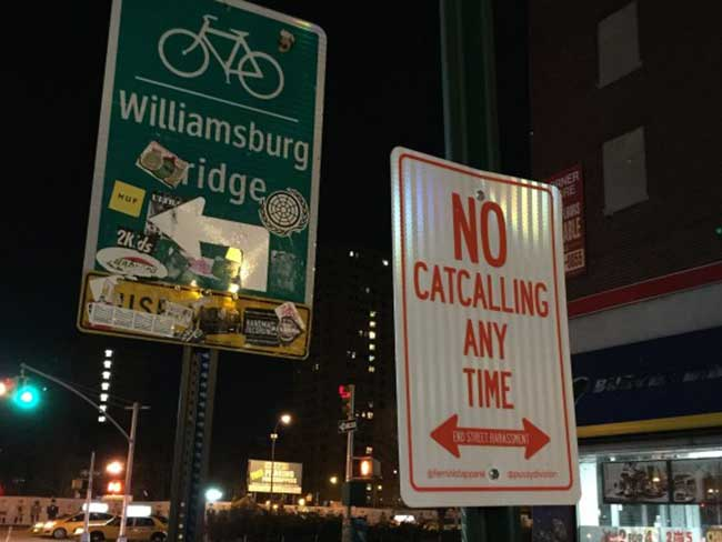 There are anti-catcalling signs posted around New York