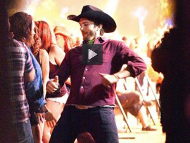 Ashton and Mila moshing to country music will make your day