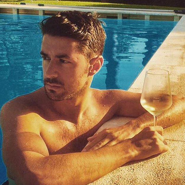 An over-the-shoulder contemplative stare and wine on the edge of the pool. We're immersed.