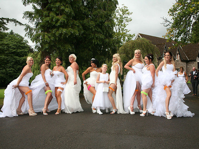 These grooms dressed their 10 bridesmaids in wedding gowns