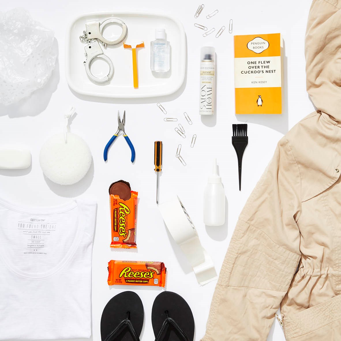 This is EXACTLY what we imagine our favourite fictional ladies would #FlatLay if we could follow them in real life. **Case in point: Piper Chapman from *Orange Is the New Black*** @piperchapman-oitnb: Only 2 hours and 23 minutes until lunch.🍔🍔 #bored #jailsucks #hittingthevendo #oneflewoverthecuckoosnest #kenkesey #razors #peanutbuttercups #instantrootconcealer #charlesworthington #plierset #parka @forevernew_official #tshirt @cottonon #thongs @targetaus