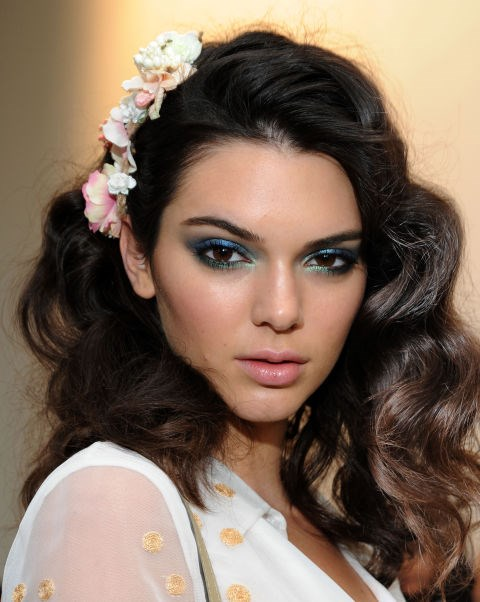 **DIANE VON FURSTENBERG** Models including Kendall Jenner (pictured) rocked 'The Diane' 'do, inspired by how the designer herself wore her curly hair in the 70s. Hairstylist Orlando Pita was behind the look, creating rows of buns in the models' hair to form curls when unraveled (get the how-to here!). To complete the Studio 54-inspired look, renowned makeup artist Pat McGrath applied aquamarine eye shadow around the eyelids; upper and lower lash lines, then plenty of black mascara. ** **