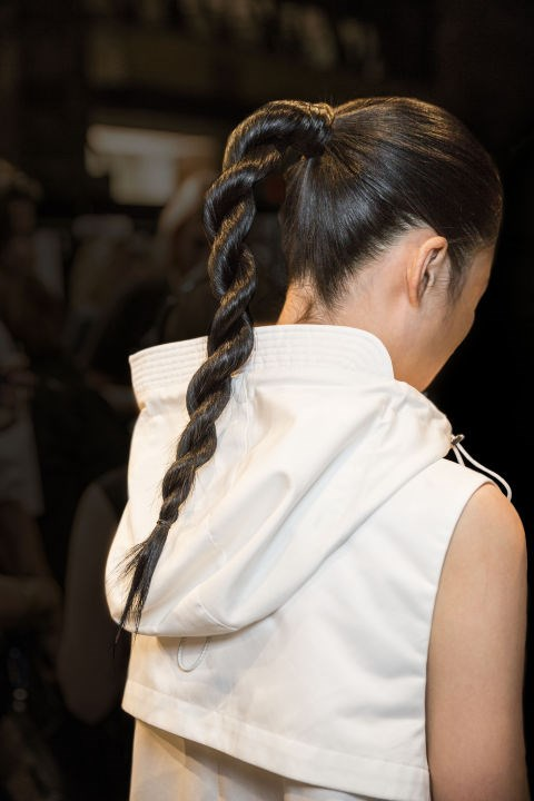 **PUBLIC SCHOOL** We loved the rope braid (or 'power braid' as they coined it) hairstyle at the Public School show in New York. Aveda's Allen Ruiz was behind the look, who used the brand's Smooth Infusion Nourishing Style Cream twice on the models; once to smooth the ponytails in prep for the clockwise twisting of two sections to the end of the hair, and again to smooth over any flyaways.