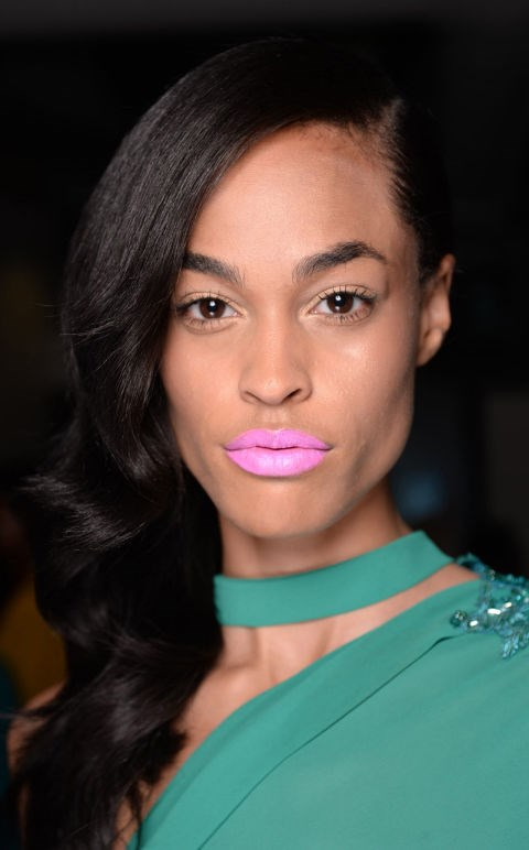 "**MICHAEL COSTELLO** This is a purely decadent 70s look. Inspired by a Studio 54 pool party, Uzo, NARS International Lead Makeup Stylist said ""we loved the idea of a bold, matte mod icy-pink lip paired with shimmery eyes and soft, illuminated skin."" So do we! Try the NARS Roman Holiday Lipstick to get the look."