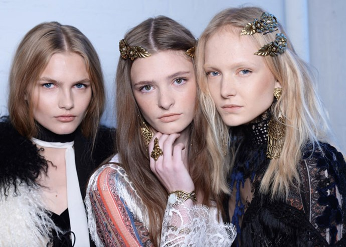 "**RODARTE** The Rodarte models wore metallic floral hair barrettes and makeup ""inspired by a dewy glow"" according to makeup artist James Kaliardos who used NARS to give them youthful colourings ""based on the sunrise and horizon."""