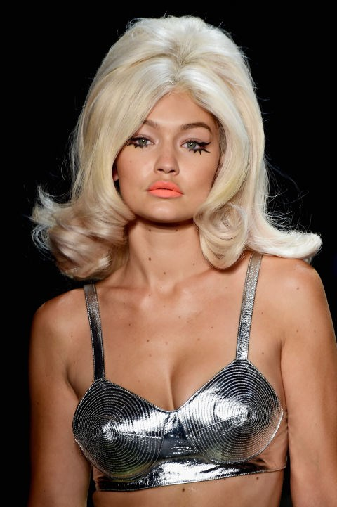 **JEREMY SCOTT** 60s silhouettes ruled at Jeremy Scott in New York where makeup artist Kabuki was inspired by Amy Winehouse to draw winged eyelashes on the models using three MAC eyeliners. The bouffant-style wigs (as modelled by Gigi Hadid) were as cartoony as the collection.